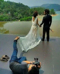 摄影师穷的助手都请不起了。
